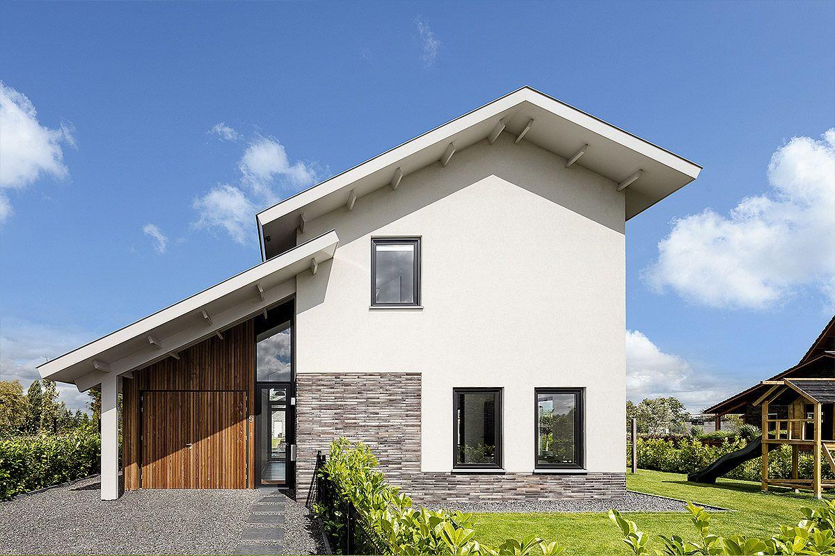 ontwerp nieuwbouwwoning met stucwerk en lange baksteen