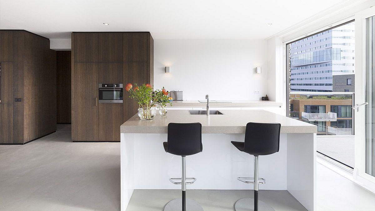 Ontwerp loft appartement door BNLA Architecten. Open woon- en eetkamer