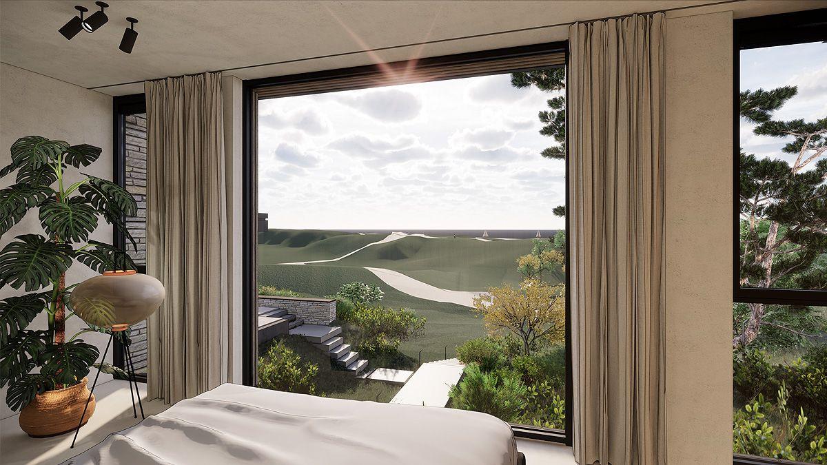 Interieur met uitzicht op duinen. Ontwerp BNLA Architecten